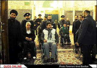 غبار روبی مضجع مطهررضوی باحضورجانبازان نخاعی/گزارش تصویری