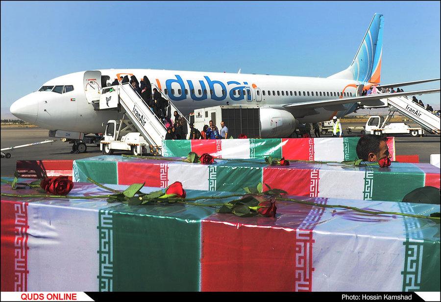 پیکر پاک و مطهر 19 شهید گمنام دفاع مقدس عصر پنج شنبه وارد فرودگاه بین المللی شهید هاشمی نژاد مشهد شد. گزارش تصویری