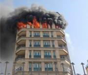 آتش سوزی دریک مجتمع مسکونی 9 طبقه در شمال تهران