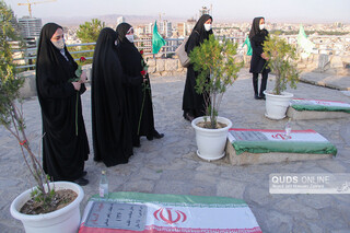 عطر افشانی مزار شهدای گمنام توسط اهالی رسانه